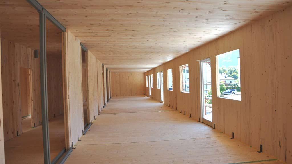 Holzverkleideter Raum zeigt Boom im Holzbau und ist Teil der Systemplanung