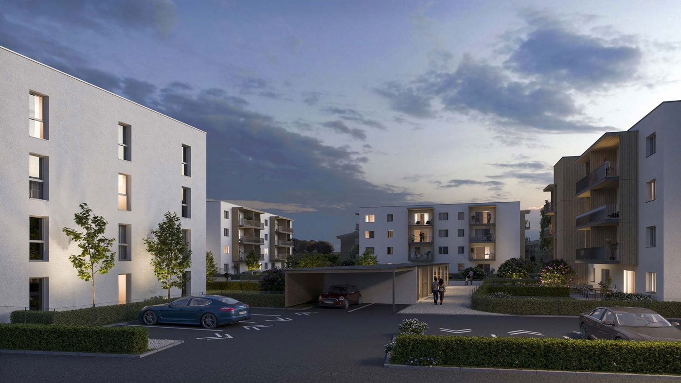 Projekt Novus Via Villach 4 Wohngebaeude mit Parkplatz in Abendstimmung